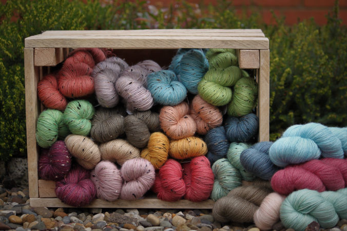 Crate full of Naturally hand-dyed yarn
